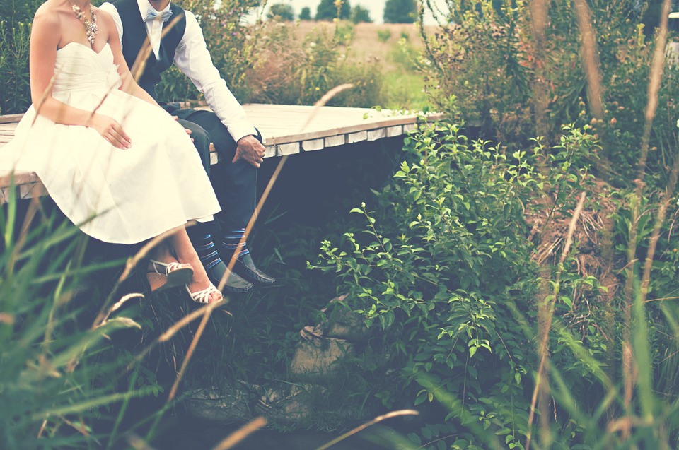 Handfasting - Wiccan pagan marriage ceremony - bride and groom in nature